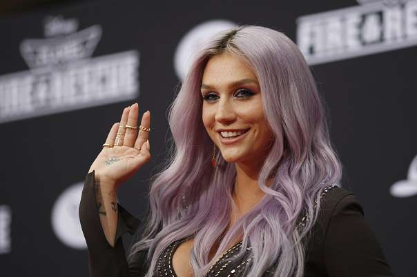 "Recording artists Kesha arrives to the premiere of ""Planes: Fire & Rescue"" at the El Capitan Theater in the Hollywood section of Los Angeles, California, July 15, 2014.  REUTERS/David McNew (UNITED STATES - Tags: ENTERTAINMENT) - RTR3YTOB"